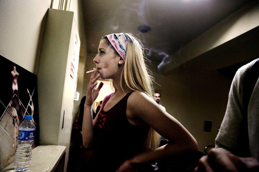 In this March 23, 2017 photo, a Serbian ballerina smokes a cigarette while taking a break during a rehearsal at Egypt's Cairo Opera House. (AP Photo/Nariman El-Mofty)