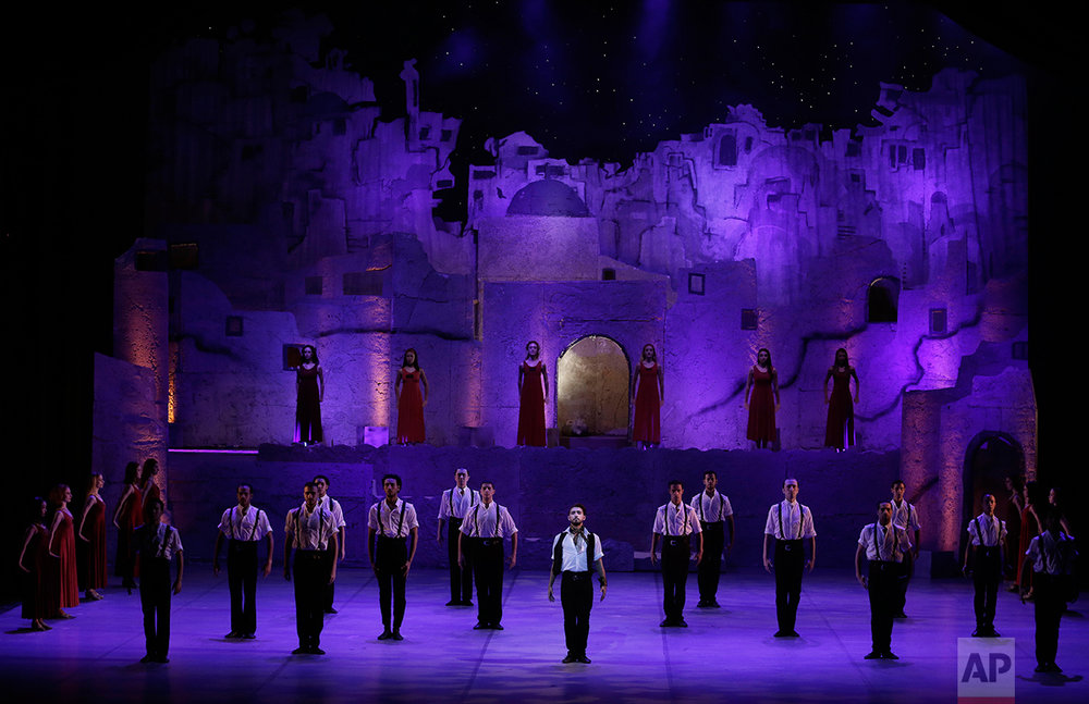 "In this March 30, 2017 photo, Egyptian ballet dancer Mohammed Hamed, center, performs during ""Zorba"" at the Cairo Opera House, in Egypt. (AP Photo/Nariman El-Mofty)"