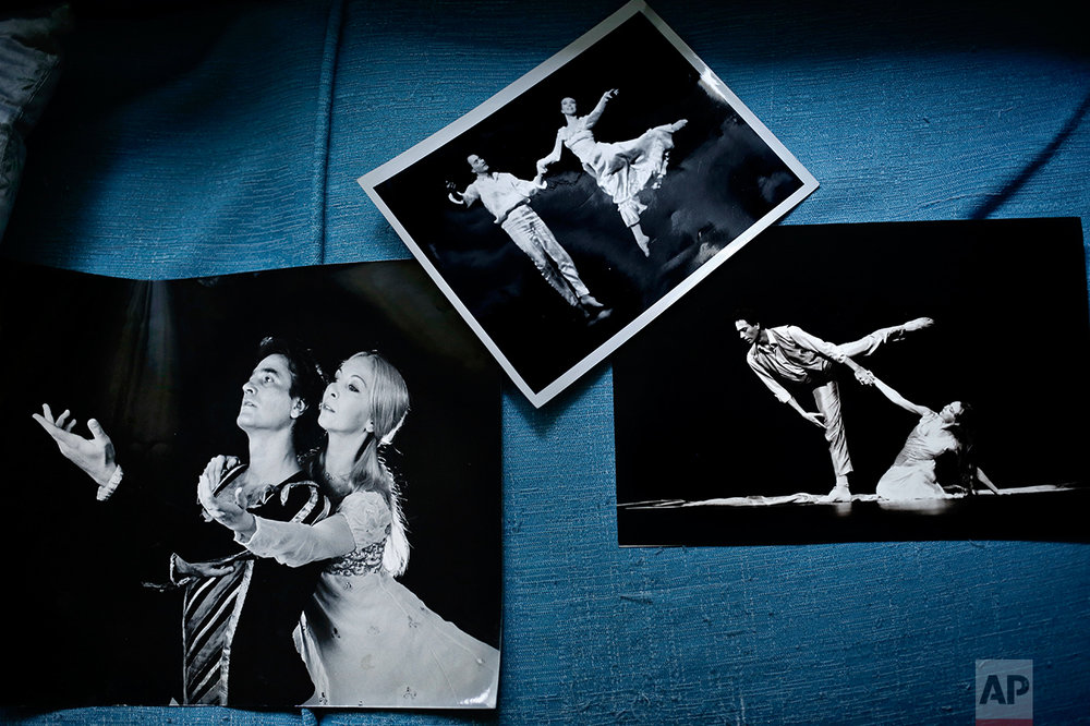 This April 14, 2017 photo, shows a display of old photographs of the late Abdel-Moneim Kamel and his wife Madame Erminia Gambarelli, the current artistic director of Egypt's national ballet company, at their apartment in Garden City, Cairo, Egypt. Kamel, the giant of Egyptian ballet who rebuilt the company in the 1990s, mentored many of its current dancers and died in 2013. (AP Photo/Nariman El-Mofty)