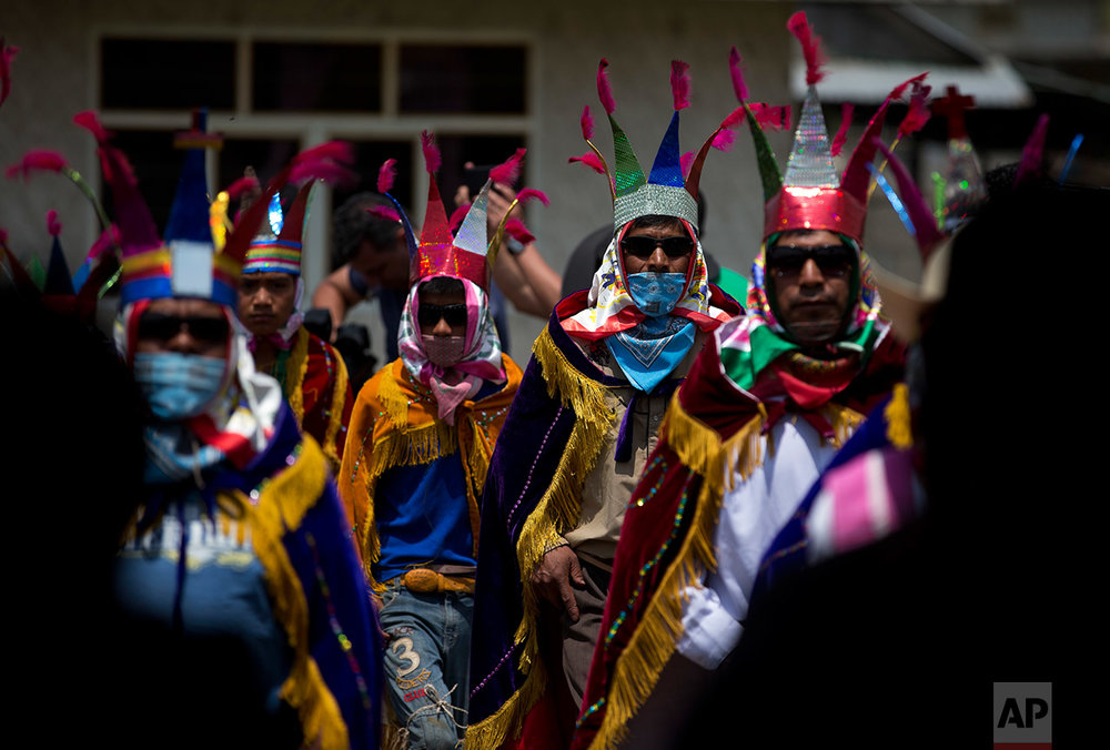 Traditional dancers perform at a wake for 12 of the 14 killed in a fireworks explosion in the village of San Isidro, Puebla State, Wednesday, May 10, 2017. (AP Photo/Rebecca Blackwell)