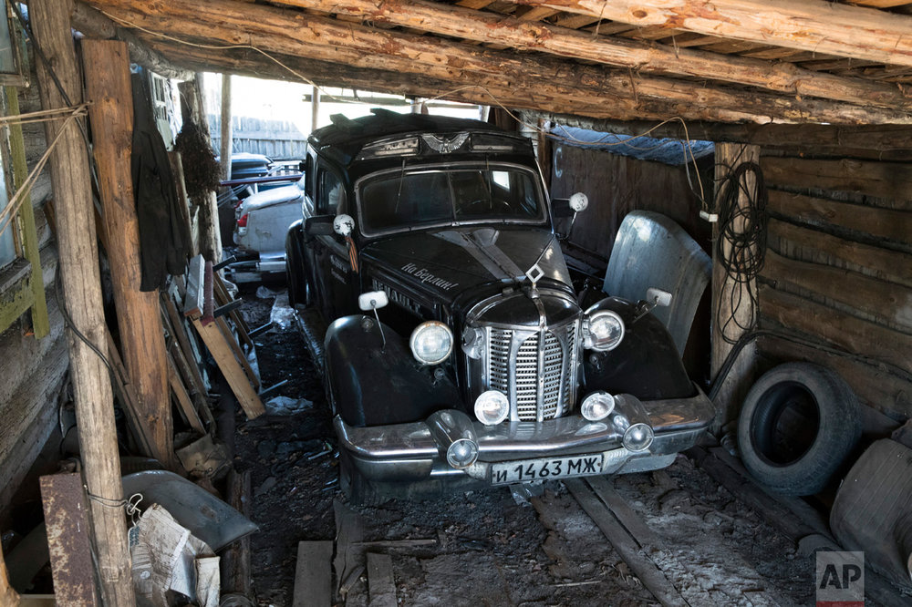 In this photo taken on Wednesday, May 3, 2017, an old Renault car brought by Mikhail Korhunov's father from Germany after WWII as a trophy is parked in the village of Severnaya Griva, about 130 kilometers (80 miles) east of Moscow, Russia. (AP Photo/Pavel Golovkin)