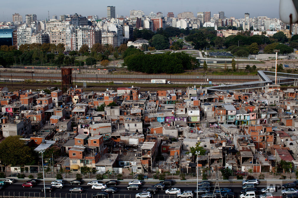 This May 5, 2017 photo shows an overview of Villa 31 slum in Buenos Aires, Argentina. A city program in Argentina's capital aims to integrate the historic Villa 31 slum into the urban fabric of the capital by offering its residents improved homes, sewage, running water, and a connection to the power grid by 2020. Slum dwellers see it with a mixture of hope and mistrust. (AP Photo/Natacha Pisarenko)