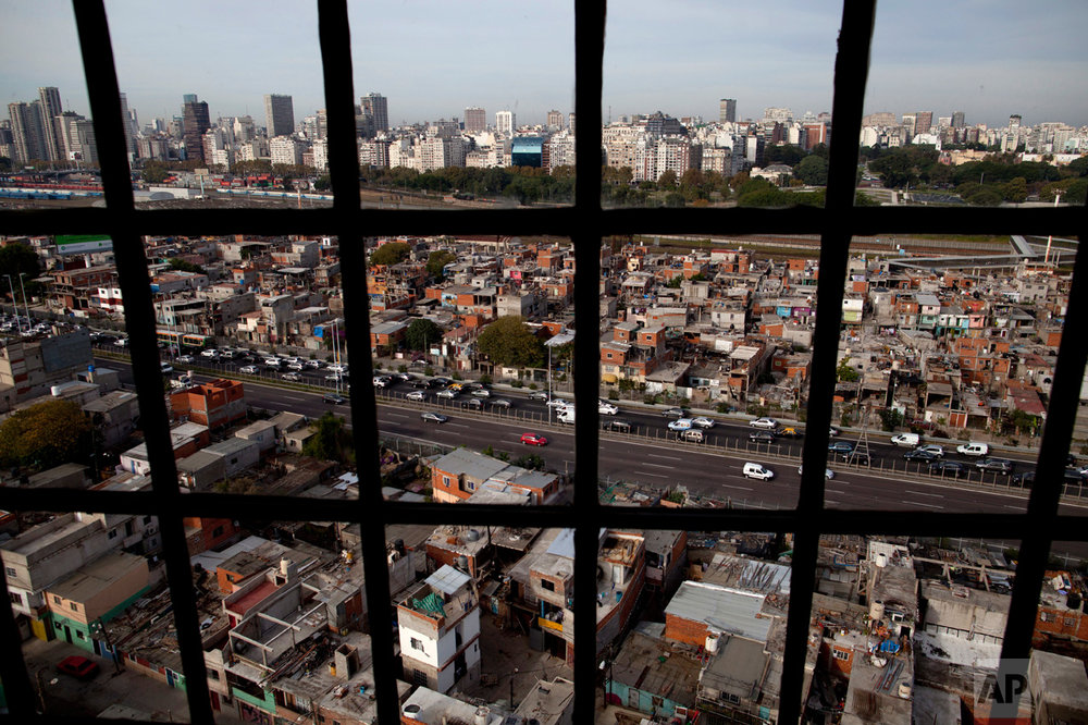 This May 5, 2017 photo shows an overhead view of the Villa 31 slum, seen from a police headquarters in Buenos Aires, Argentina. Sitting next to the most sophisticated neighborhood of Buenos Aires, the sprawling slum is about to get a serious face lift. (AP Photo/Natacha Pisarenko)