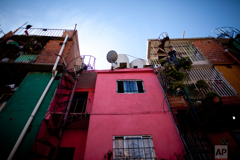 This May 2, 2017 photo shows a home painted bright pink in the Villa 31 slum in Buenos Aires, Argentina. Villa 31 is one of the oldest slums, dating back to the 1930s, and one of the best-known because of its central location near the business district and the elegant French-inspired buildings of the Recoleta neighborhood. (AP Photo/Natacha Pisarenko)