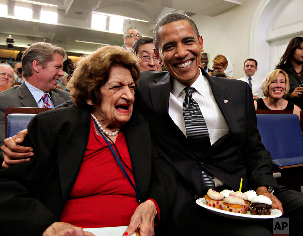 In this Aug. 4, 2009 photo, President Barack Obama, marking his 48th birthday, takes a break from his official duties to bring birthday greetings to veteran White House reporter Helen Thomas, left, who shares the same birthday and turns 89, in the White House Press Briefing Room in Washington. Thomas abruptly retired Monday, according to her employer, Hearst News Service.  (AP Photo/J. Scott Applewhite)