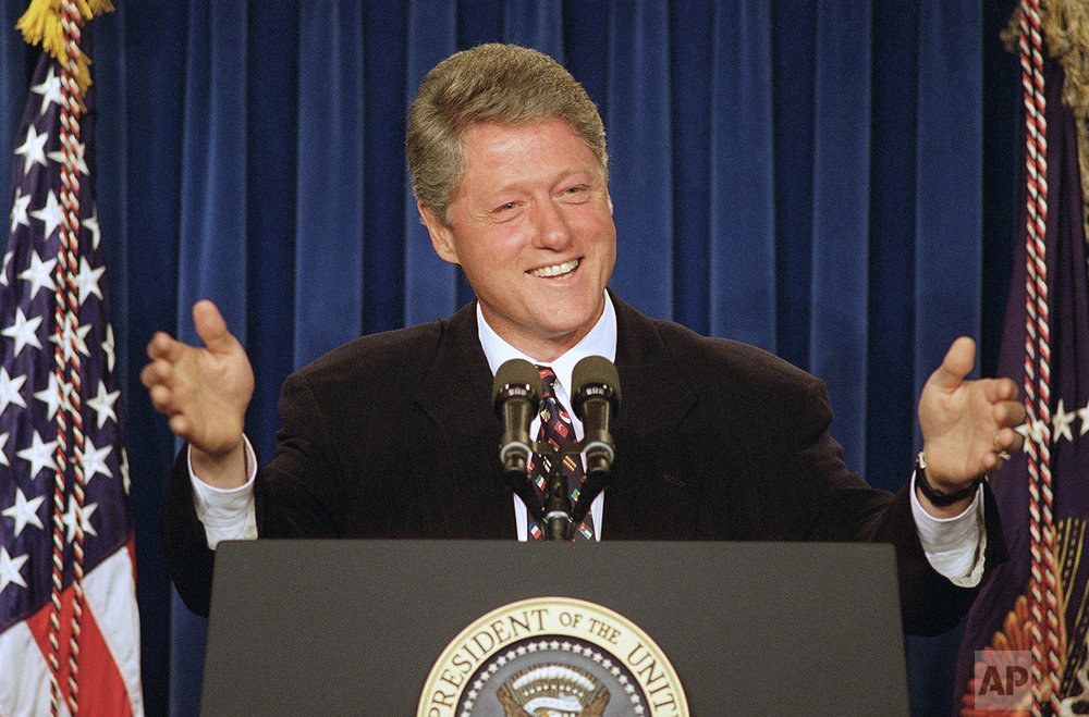 President Bill Clinton smiles and gestures during a news conference in the White House briefing room in Washington on Tuesday, June 15, 1993. The president jokingly gave ABC television reporter Brit Hume a fresh chance to question him, one day after tersely rejecting a query from the White House correspondent at a Rose Garden news conference (AP Photo/Dennis Cook)