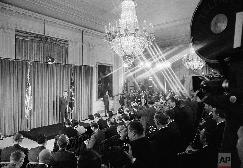 President Richard Nixon answers a question as he meets with reporters in a news conference held in the East Room of the White House on Jan. 27, 1969 in Washington.   It was Nixon's first conference since his January 20 inauguration. (AP Photo)