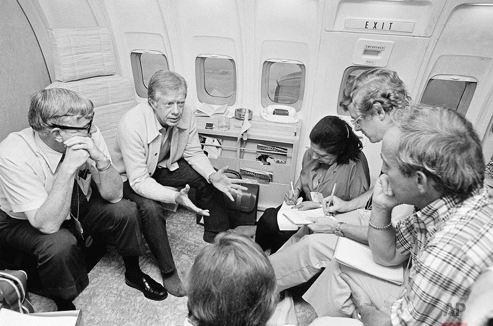 President Jimmy Carter meets with newsmen aboard Air Force One on July 1, 1979, while flying from Seoul, South Korea, to Honolulu. Carter said as a result of the OPEC increase in the price of oil he feels the country is due for a recession with a many as 800,000 Americans out of work. (AP Photo/Ira Schwarz)