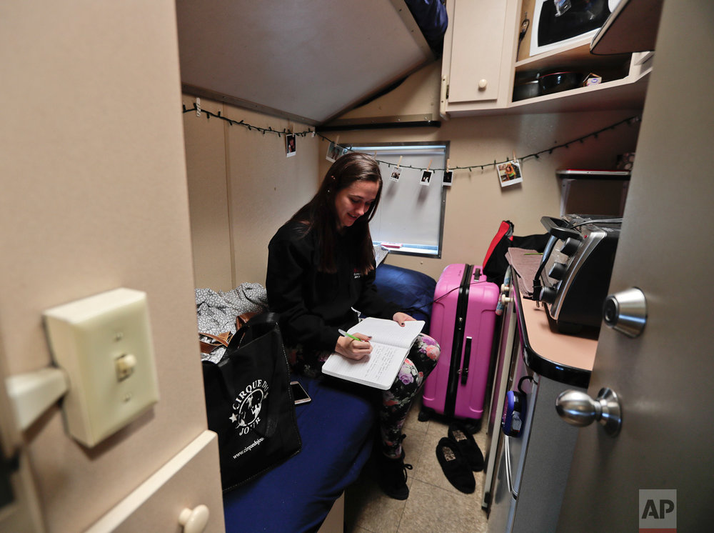 Ringling Bros. clown Beth Walters writes in a journal in her living quarters on the circus' train before heading off to the arena to perform in a show, Thursday, May 4, 2017, in Providence, R.I. Walters had taken down most of the photos and decorations in her room to prepare to move out and head home after the red unit's final performance. (AP Photo/Julie Jacobson)