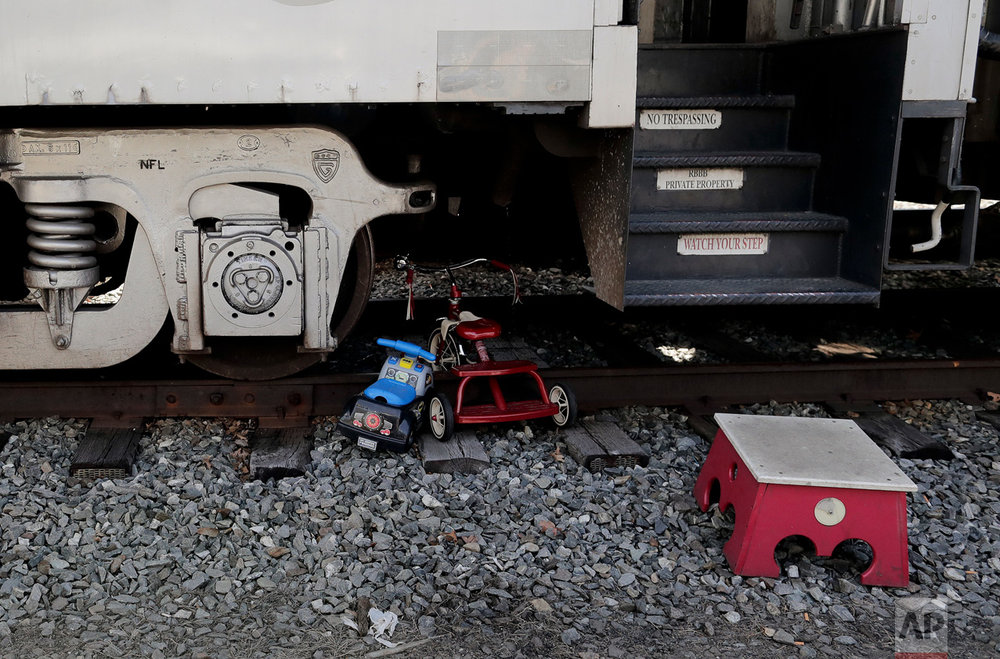 "Children's toys sit on the train tracks beneath the Ringling Bros. and Barnum & Bailey Circus train as it sits parked in a rail yard, Thursday, May 4, 2017, in Providence, R.I. ""The Greatest Show on Earth"" is about to put on its last show on earth. For the performers who travel with the Ringling Bros. and Barnum & Bailey Circus, its demise means the end of a unique way of life for hundreds of performers and crew members. (AP Photo/Julie Jacobson)"