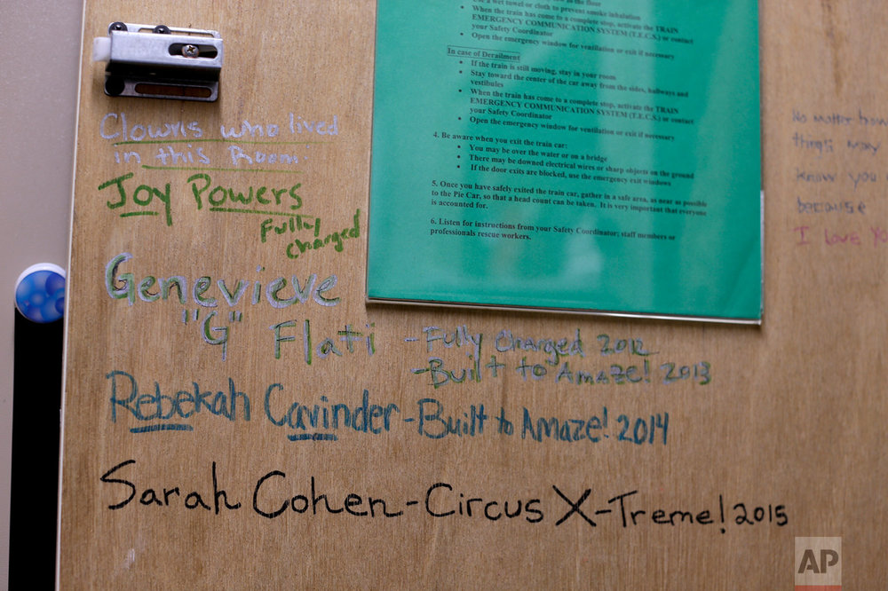"A cabinet door inside a clown's living quarters on the train displays messages and signatures from past clowns who have lived in that room, Thursday, May 4, 2017, in Providence, R.I. ""The Greatest Show on Earth"" is about to put on its last show on earth. For the performers who travel with the Ringling Bros. and Barnum & Bailey Circus, its demise means the end of a unique way of life for hundreds of performers and crew members. (AP Photo/Julie Jacobson)"