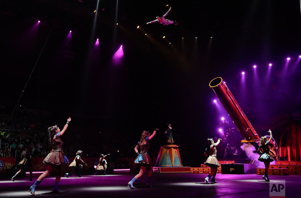 "Nicole Sanders flies through the air after being shot from a cannon during a show, Thursday, May 4, 2017, in Providence, R.I. ""The Greatest Show on Earth"" is about to put on its last show on earth. For the performers who travel with the Ringling Bros. and Barnum & Bailey Circus, its demise means the end of a unique way of life for hundreds of performers and crew members. (AP Photo/Julie Jacobson)"