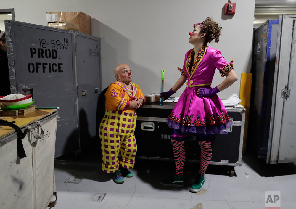 "Clowns Gabor Hrisafis, left, and Beth Walters talk in a hallway of the Dunkin Donuts center before a performance, Thursday, May 4, 2017, in Providence, R.I. ""The Greatest Show on Earth"" is about to put on its last show on earth. For the performers who travel with the Ringling Bros. and Barnum & Bailey Circus, its demise means the end of a unique way of life for hundreds of performers and crew members. (AP Photo/Julie Jacobson)"