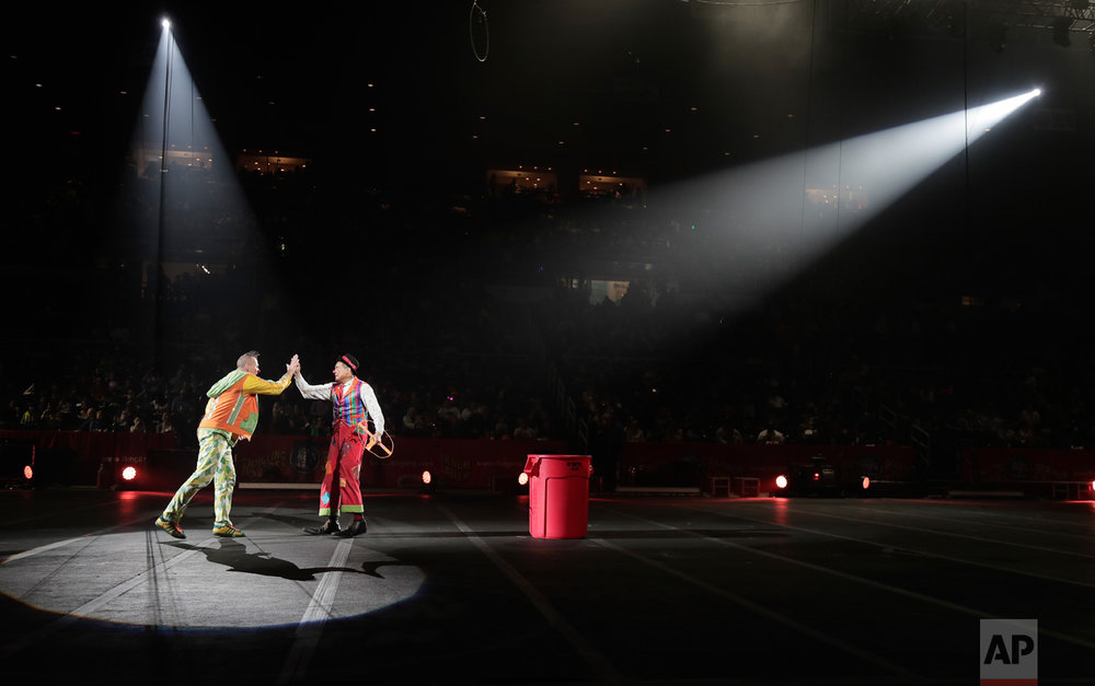 "Ringling Bros. clowns Sandor Eke, left, and Ivan Skinfill perform during the intermission of a show, Saturday, May 6, 2017, in Providence, R.I. Knowing it's coming to an end has been difficult for his fellow performers and crew, and Eke been spending his time trying to make his circus family laugh. ""I don't stop until they smile. And I do everything. I don't care if I have to dive into a trash can. That's how I want to be remembered. And that's how I want to remember myself,"" he says. ""I'm going to go and cry. But I'm going to be happy."" (AP Photo/Julie Jacobson)"