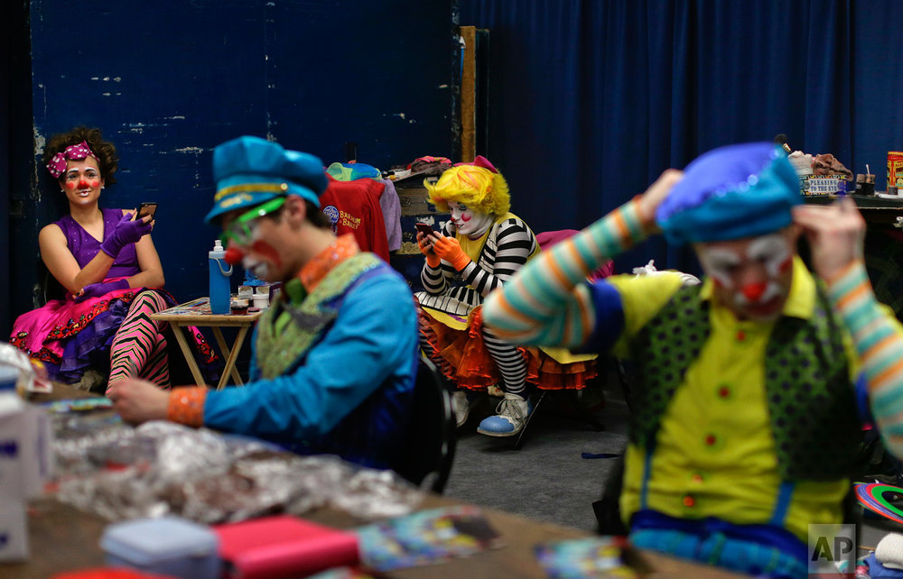 "Ringling Bros. clowns take a break between acts in ""Clown Alley,"" a private area backstage, Friday, May 5, 2017, in Providence, R.I. Clown Alley is not just a place: the private area backstage where clowns get ready to perform. It's how the clowns refer to themselves, a mini-fraternity within the circus, and a microcosm of it. (AP Photo/Julie Jacobson)"