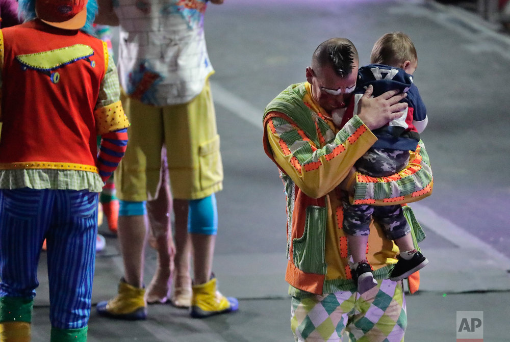 "Ringling Bros. boss clown Sandor Eke hugs his 2-year-old son Michael after the red unit's final show, Sunday, May 7, 2017, in Providence, R.I. ""The Greatest Show on Earth"" is about to put on its last show on earth. (AP Photo/Julie Jacobson)"