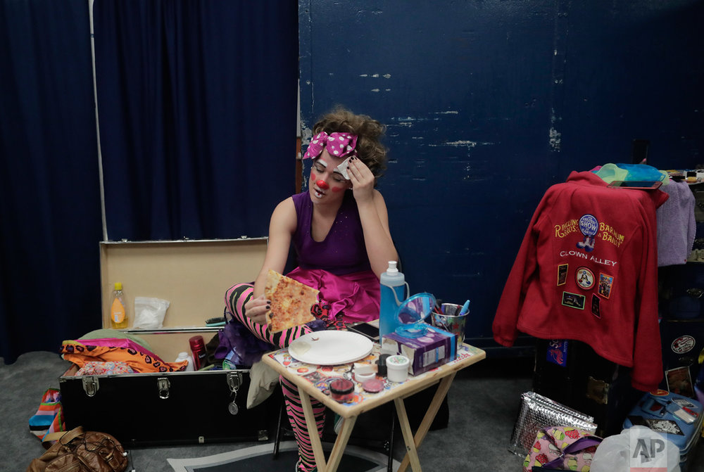 "Beth Walters, takes a break in Clown Alley between acts during a show with the Ringling Bros. Barnum and Bailey Circus red unit, Friday, May 5, 2017, in Providence, R.I. ""The Greatest Show on Earth"" is about to put on its last show on earth. For the performers who travel with the Ringling Bros. and Barnum & Bailey Circus, its demise means the end of a unique way of life for hundreds of performers and crew members. (AP Photo/Julie Jacobson)"