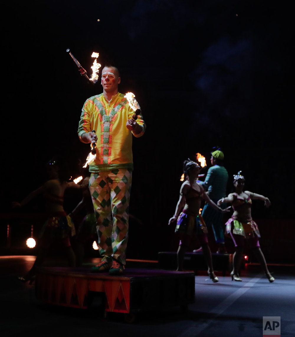 "Boss clown Sandor Eke juggles with fire during a show, Thursday, May 4, 2017, in Providence, R.I. ""The Greatest Show on Earth"" is about to put on its last show on earth. For the performers who travel with the Ringling Bros. and Barnum & Bailey Circus, its demise means the end of a unique way of life for hundreds of performers and crew members. (AP Photo/Julie Jacobson)"