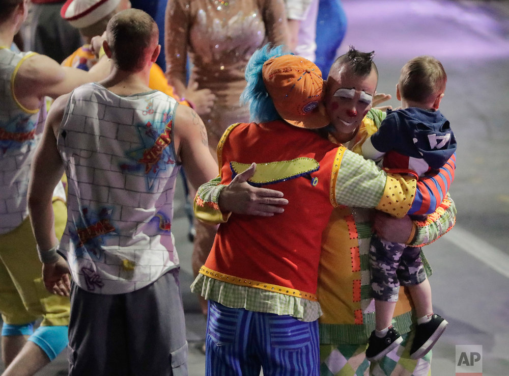 "Boss clown Sandor Eke hugs fellow clowns as he holds his 2-year-old son, Michael after the red unit's final performance, Sunday, May 7, 2017, in Providence, R.I. ""The Greatest Show on Earth"" is about to put on its last show on earth. For the performers who travel with the Ringling Bros. and Barnum & Bailey Circus, its demise means the end of a unique way of life for hundreds of performers and crew members. (AP Photo/Julie Jacobson)"