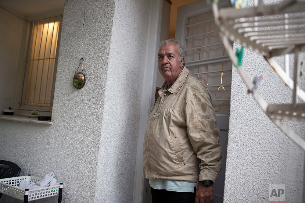 "In this Wednesday, May 17, 2017 photo, Greek pensioner Paraksevas Kokkinakis, 71, a former private bank manager, poses outside his house in Athens. Kokkinakis had never expected to face financial difficulties later in life , he said, ""It never crossed my mind that there would be a time when this care-free period, let's call it, would turn into anxiety."" (AP Photo/Petros Giannakouris)"
