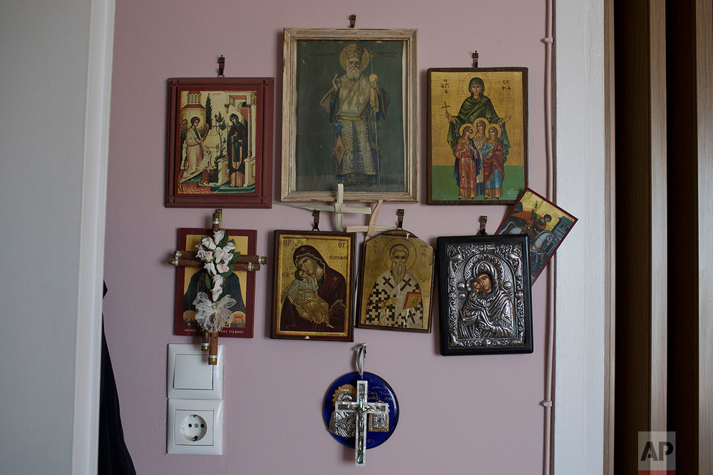 "In this Monday, May 15, 2017 photo, religious icons hang in the home of Greek pensioner Mina Griva, 78, in Athens. Greek retirees say they are struggling to survive on ever dwindling pensions with repeated cuts imposed by successive governments as part of their country's three international bailouts. ""Now you can't even buy a bread ring for your grandchildren"", Griva said. ""I don't know where this will go. Things are very, very hard."" (AP Photo/Petros Giannakouris)"