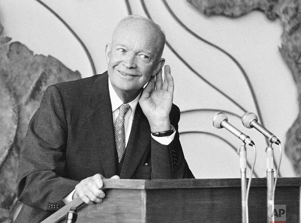 In this Aug. 27, 1959 photo, Pres. Dwight D. Eisenhower cups his ear as he listens to a question from a newsman at a news conference at the West German Foreign Ministry, in Bonn, Germany. Going back to 1956, no incumbent president has lost when unemployment fell over the two years leading up to the election. (AP Photo)
