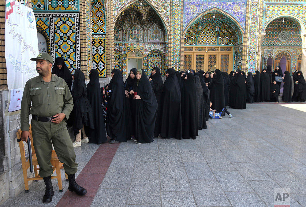 Female voters queue at a polling station for the presidential and municipal council election in the city of Qom, Iran, 78 miles (125 kilometers) south of the capital Tehran, Friday, May 19, 2017. Iranians began voting Friday in the country's first presidential election since its nuclear deal with world powers, as incumbent Hassan Rouhani faced a staunch challenge from a hard-line opponent over his outreach to the wider world. (AP Photo/Ebrahim Noroozi)