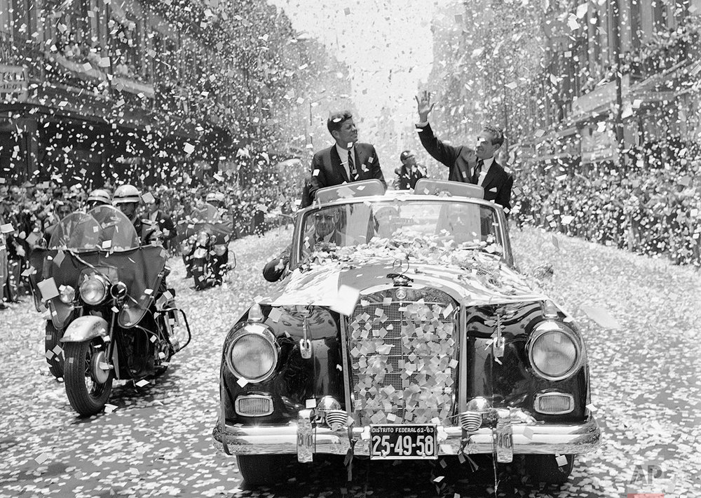 U.S. President John F. Kennedy and Mexican President Adolfo Lopez Mateos are showered with tons of confetti and paper, June 29, 1962, as they travel down one of Mexico City's boulevards shortly after Kennedy's arrival for a three-day visit. (AP Photo)