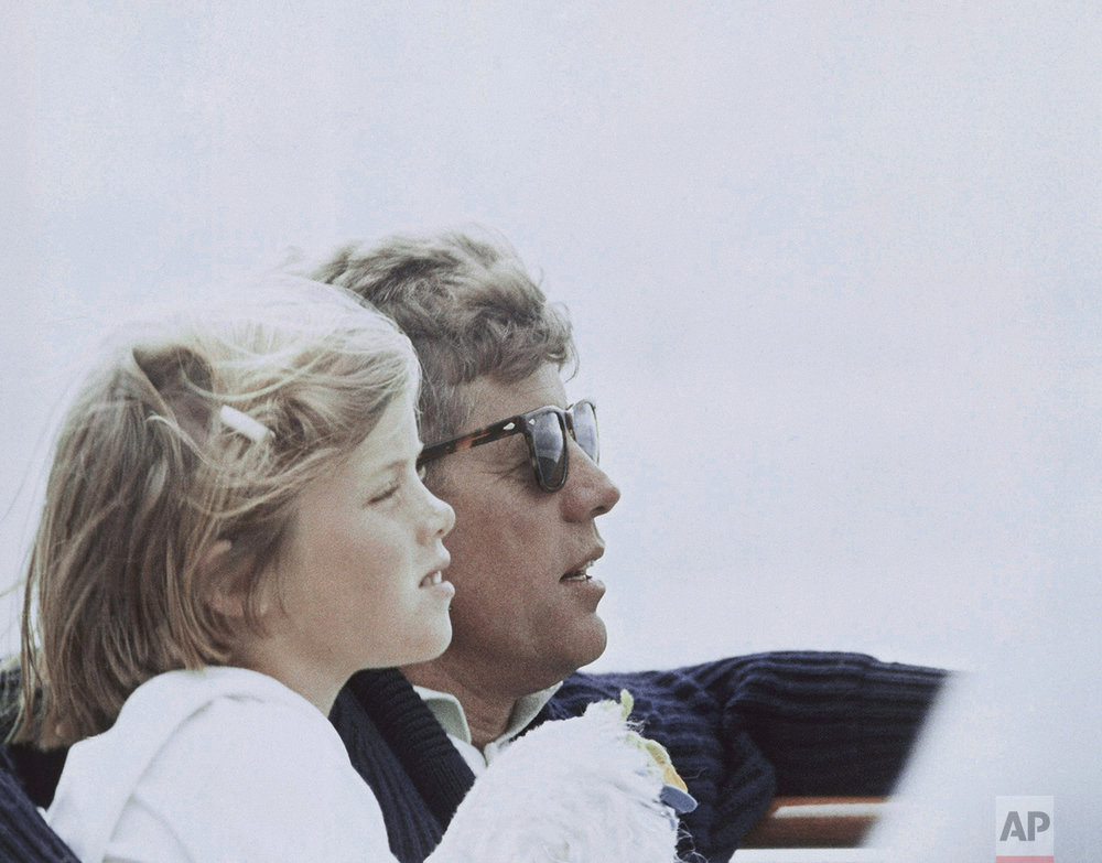In this photo provided by the White House, President John F. Kennedy is shown with his daughter Caroline in Hyannis Port, Mass., Aug. 25, 1963. (AP Photo/White House/Cecil Stockton)