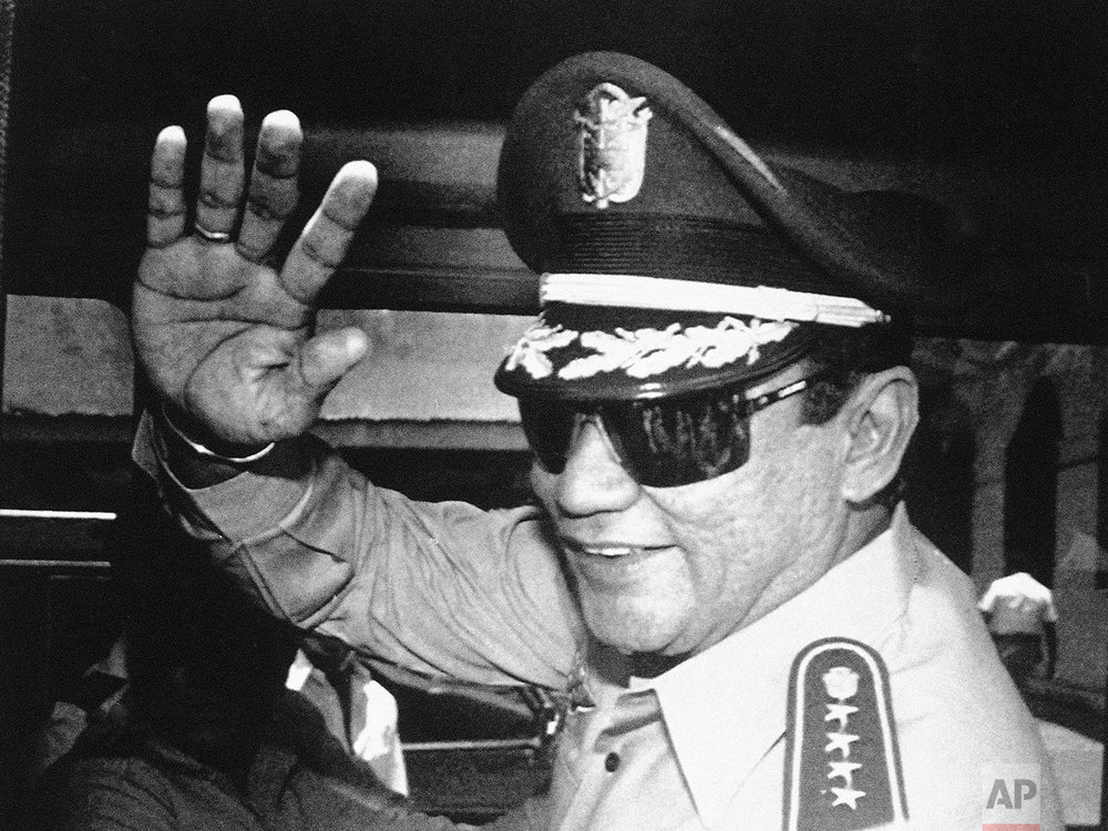 In this Aug. 31, 1989 photo, Gen. Manuel Antonio Noriega waves to newsmen after a state council meeting, at the presidential palace in Panama City, where they announced the new president of the republic. Panama's ex-dictator Noriega died Monday, May 29, 2017, in a hospital in Panama City. He was 83. (AP Photo/Matias Recart)