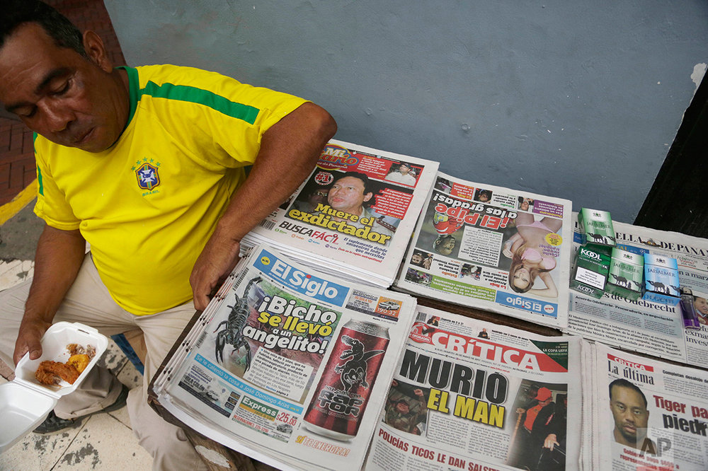 "A man sells newspapers with the death of former Panamanian strongman Manuel Antonio Noriega as the main headline, in Panama City, Tuesday, May, 30, 2017. Former Panamanian dictator Manuel Noriega died late Monday. Panamanian President Juan Carlos Varela wrote in his Twitter account that ""the death of Manuel A. Noriega closes a chapter in our history."" (AP Photo/Arnulfo Franco)"