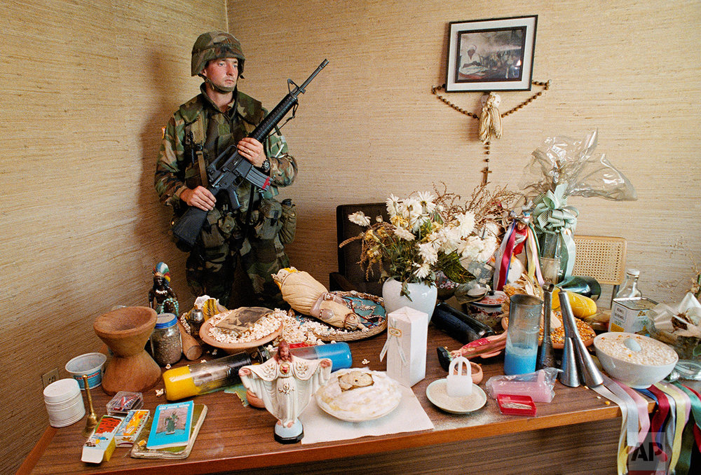 A U.S. soldier stands guard in a room containing cult items in a house near Gen. Manuel Antonio Noriega's Ft. Armador PDF barrack's office in Panama City December 22, 1989. Noriega, Panama's leader, has been seen at the house several times in the last couple of months in 1989. The house was thought to be used for cult ceremonies and witchcraft. (AP Photo/pool/DOD)