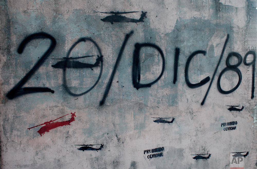 In this photo taken on Dec. 4, 2011, graffiti depicts the date of the U.S. invasion of Panama in the Chorrillo neighborhood where Panama's former dictator Manuel Noriega had his headquarters in Panama City.  (AP Photo/Arnulfo Franco)
