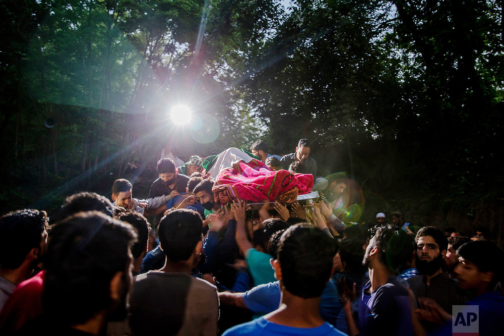 Kashmiris carry the body of rebel leader Sabzar Ahmed Bhat towards his home after displaying it to villagers in the Tral area, 45 kilometers (28 miles) south of Srinagar, Indian controlled Kashmir, on Saturday, May 27, 2017. Police said Bhat and a fellow militant were killed after troops cordoned off the southern Tral area overnight following a tip that rebels were hiding there. (AP Photo/Dar Yasin)