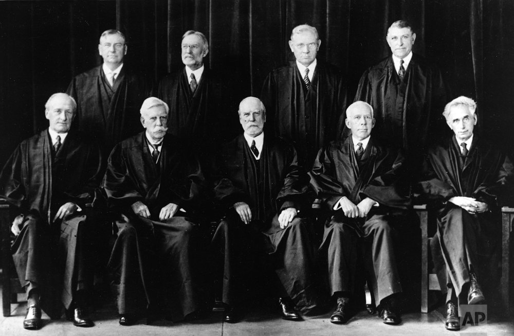 Members of the Supreme Court of the United States are shown in Washington, D.C., on Oct. 13, 1930.  Standing from left are, Justices Harlan F. Stone, George Sutherland, Pierce Butler, and  Owen J. Roberts.  Seated from left are, Justices James C. McReynolds, Oliver W. Holmes, Chief Justice Charles E. Hughes, Willis Van Devanter and Louis D. Brandeis.  (AP Photo)