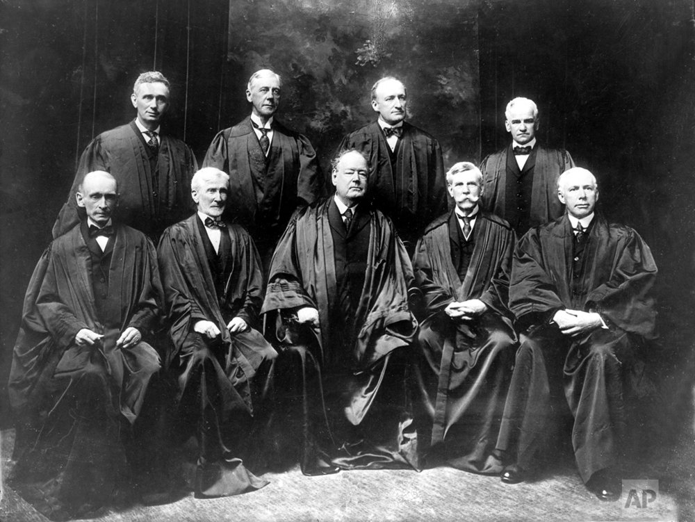 The nine members of the U.S. Supreme Court pose in their robes in New York City in 1917.  Standing from left are, Justice Louis D. Brandeis, Mahlon Pitney, James C. McReynolds and John H. Clarke.  Seated from left are, William R. Day, Joseph McKenna, Chief Justice Edward D. White, Oliver Wendell Holmes, and, W. Van Devanter.  (AP Photo)