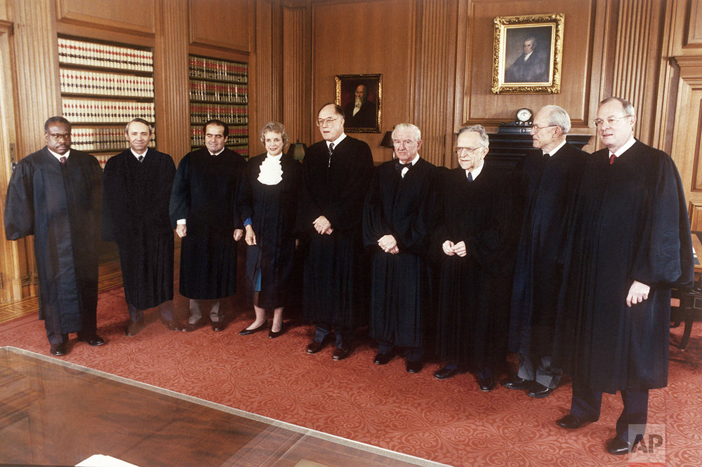 Supreme Court Justices gather at the court for a formal portrait in Washington, Nov. 1, 1991. From left are, Clarence Thomas, David Souter, Antonin Scalia, Sandra Day O'Connor, Chief Justice William Rehnquist, John Paul Stevens, Harry Blackmun, Byron White, and Anthony Kennedy. (AP Photo/Ken Heinen)