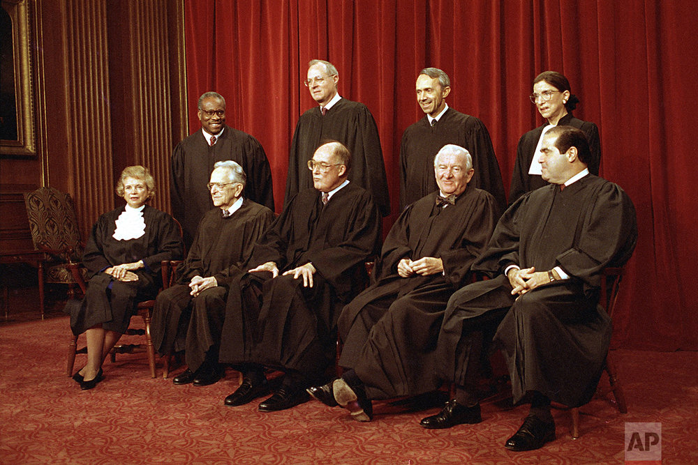 Members of the U.S. Supreme Court pose for their group portrait in Washington, Dec. 3, 1993.  Standing, from left:  Associate Justices Clarence Thomas; Anthony M. Kennedy; David Souter; and Ruth Bader Ginsburg.  Seated, from left are:  Sandra Day O'Connor, Harry Blackmun; Chief Justice William Rehnquist; John Paul Stevens; and Antonin Scalia.  (AP Photo/Marcy Nighswander)