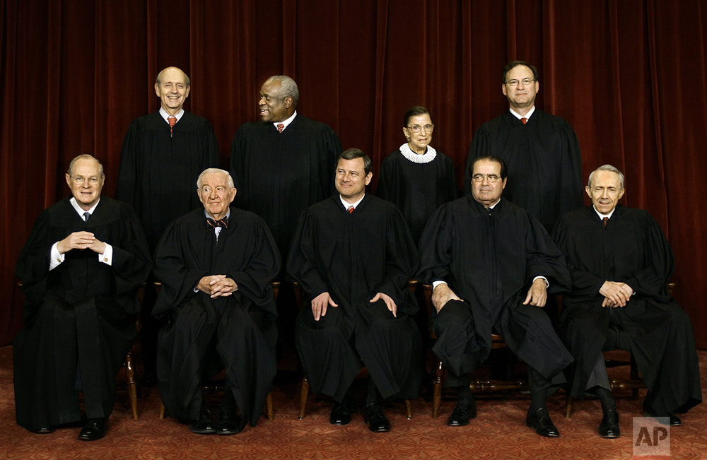 With the addition of the Supreme Court's newest member, Justice Samuel Alito Jr., top row at right, the high court sits for a new group photograph, Friday, March 3, 2006, at the Supreme Court Building in Washington. Seated in the front row, from left to right are: Associate Justice Anthony M. Kennedy, Associate Justice John Paul Stevens, Chief Justice of the United States John G. Roberts, Associate Justice Antonin Scalia, and Associate Justice David Souter. Standing, from left to right, in the top row, are: Associate Justice Stephen Breyer, Associate Justice Clarence Thomas, Associate Justice Ruth Bader Ginsburg, and Associate Justice Samuel Alito Jr. Alito who took his seat on the court Feb. 21, replacing Sandra Day O'Connor, who made history in 1981 as the first woman to join the Supreme Court. (AP Photo/J. Scott Applewhite)