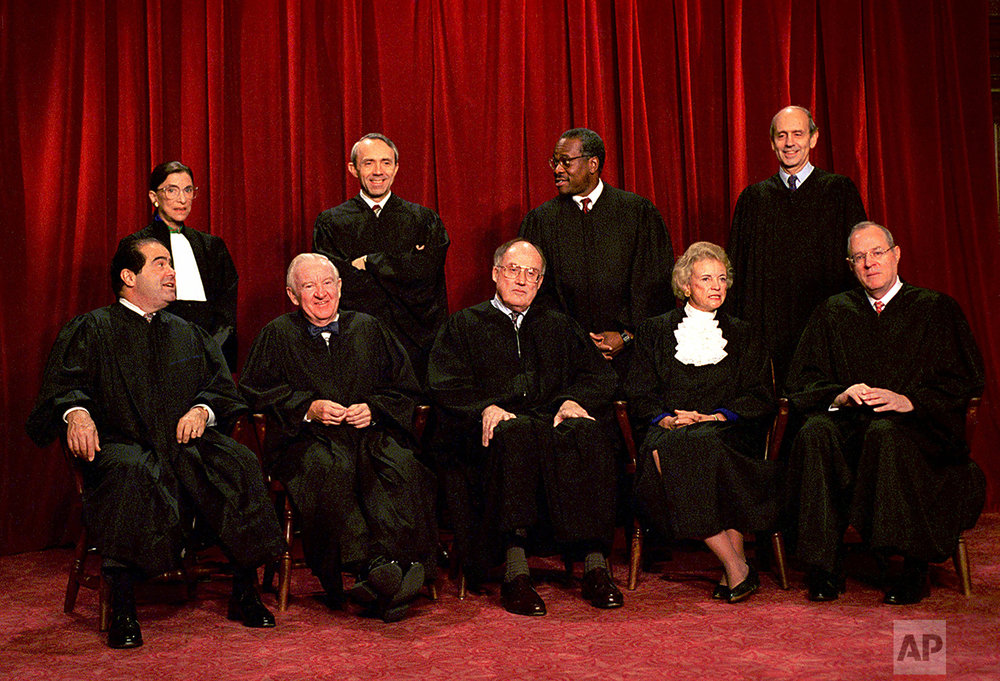 Justices of the U.S. Supreme Court pose for a group portrait Thursday, Nov. 10, 1994 at the court in Washington.  From left, front are: Associate Justices Antonin Scalia, John Paul Stevens, Chief Justice William Rehnquist, Associate Justices Sandra Day O'Connor and Anthony Kennedy.  From left, back row are: Associate Justices Ruth Bader Ginsburg, David Souter, Clarence Thomas and Stephen Breyer. (AP Photo/J. Scott Applewhite)