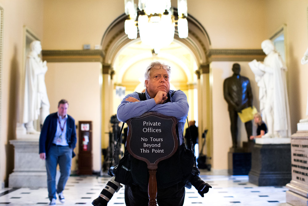 AP photographer J. Scott Applewhite watches for lawmakers in the corridors of the U.S. Capitol, July 30, 2014. (Photo courtesy Doug Mills/The New York Times)