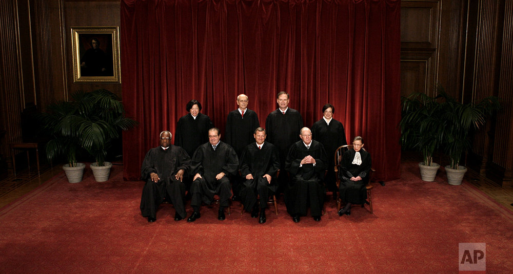 The justices of the U.S. Supreme Court gather for a group portrait at the Supreme Court Building in Washington, Friday, Oct. 8, 2010. Seated from left to right are: Associate Justice Clarence Thomas, Associate Justice Antonin Scalia, Chief Justice John G. Roberts, Associate Justice Anthony M. Kennedy, Associate Justice Ruth Bader Ginsburg. Standing, from left are: Associate Justice Sonia Sotomayor, Associate Justice Stephen Breyer, Associate Justice Samuel Alito Jr., and Associate Justice Elena Kagan. (AP Photo/Pablo Martinez Monsivais)