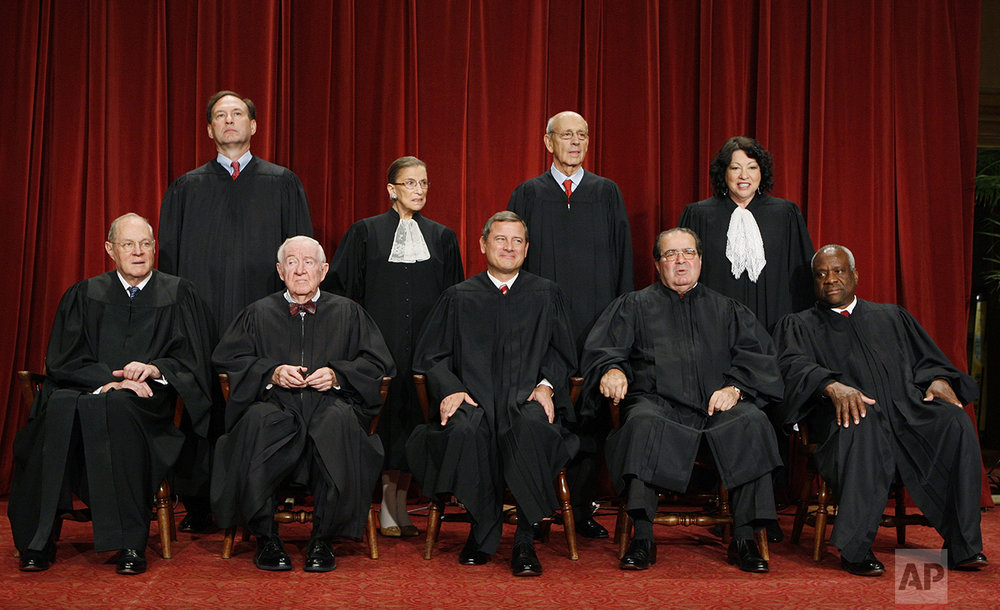 With the addition of the Supreme Court's newest member, Justice Sonia Sotomayor, top row, right, the high court sits for a new group photograph, Tuesday, Sept. 29, 2009, at the Supreme Court in Washington. Seated, from left are: Associate Justice Anthony M. Kennedy, Associate Justice John Paul Stevens, Chief Justice John G. Roberts, Associate Justice Antonin Scalia, and Associate Justice Clarence Thomas. Standing, from left are: Associate Justice Samuel Alito Jr., Associate Justice Ruth Bader Ginsburg, Associate Justice Stephen Breyer, and Associate Justice Sonia Sotomayor. (AP Photo/Charles Dharapak)
