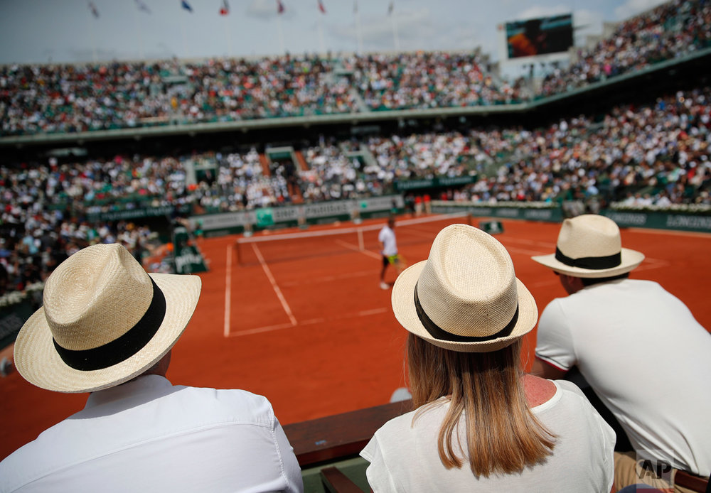 Guests watch a match on Chatrier court during the French Open tennis tournament at the Roland Garros stadium, Sunday, June 4, 2017 in Paris. (AP Photo/Christophe Ena)