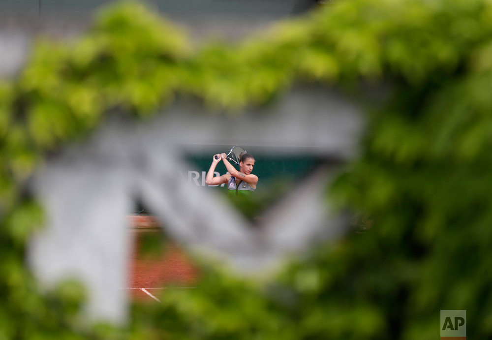 In this Sunday, June 4, 2017 photo, Karolina Pliskova of the Czech Republic returns the ball to Germany's Carina Witthoeft during their third round match of the French Open tennis tournament at the Roland Garros stadium in Paris. (AP Photo/Petr David Josek)