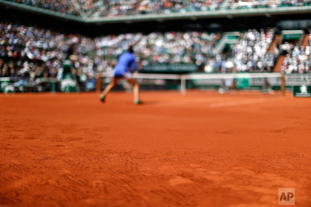 In this Wednesday, June 7, 2017 photo, prints of the players' shoes are seen on the clay as France's Caroline Garcia, rear, plays against Karolina Pliskova of the Czech Republic during their quarterfinal match of the French Open tennis tournament at the Roland Garros stadium, in Paris, France. (AP Photo/Petr David Josek)