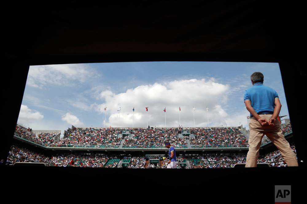 In this Wednesday, May 31, 2017 photo, Spain's Rafael Nadal prepares to serve against Netherlands' Robin Haase during their second round match of the French Open tennis tournament at the Roland Garros stadium, in Paris, France. (AP Photo/Petr David Josek)