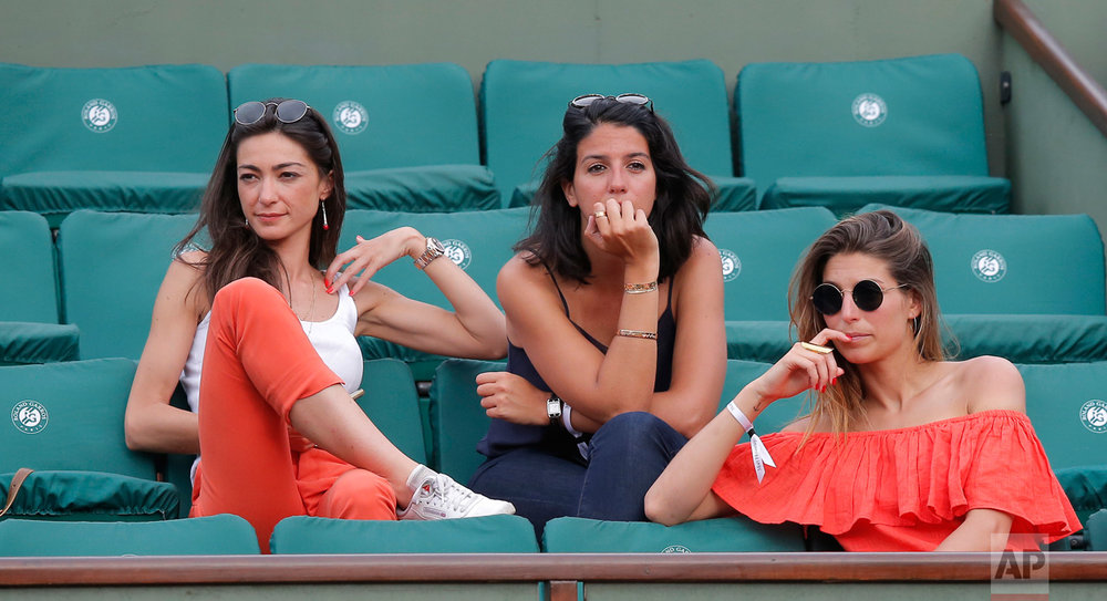 Spectators watch Karolina Pliskova of the Czech Republic play Romania's Simona Halep during their semifinal match of the French Open tennis tournament at the Roland Garros stadium, Thursday, June 8, 2017 in Paris. (AP Photo/Michel Euler)