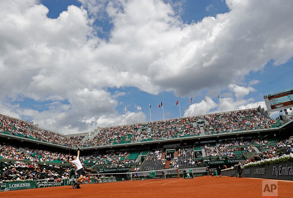 In this Monday, June 5, 2017 photo, Britain's Andy Murray serves against Russia Karen Khachanov during their fourth round match of the French Open tennis tournament at the Roland Garros stadium, in Paris, France. (AP Photo/Petr David Josek)