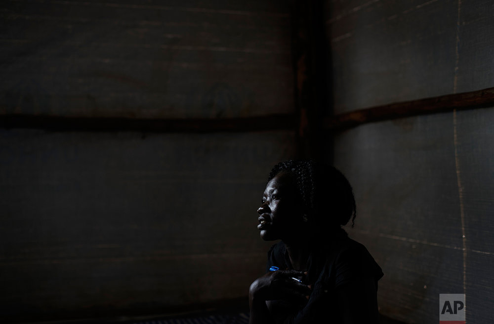 In this photo taken Saturday, June 3, 2017, Lilian Dawa, a South Sudanese refugee from Yei who manages a women's center focusing on sexual and gender-based violence, run by the aid group International Rescue Committee, speaks to The Associated Press at the center in Bidi Bidi, Uganda. (AP Photo/Ben Curtis)